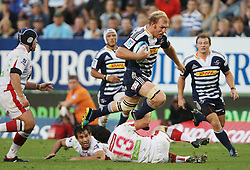 Schalk Burger of the Stormers tries to jump over Anthony Faingaa during the Super Rugby (Super 15) fixture between DHL Stormers and the Reds played at DHL Newlands in Cape Town, South Africa on 9 April 2011. Photo by Jacques Rossouw/SPORTZPICS