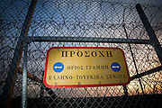 The sign reads, 'Attention Greek and Turkish border line'.  Image © Angelos Giotopoulos/Falcon Photo Agency