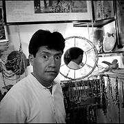 PORTRAITS / RETRATOS<br /> <br /> Angel Erazo<br /> Orfebre, Artesano y Músico Ecuatoriano<br /> Maracaibo, Estado Zulia - Venezuela 1999<br /> <br /> (Copyright © Aaron Sosa