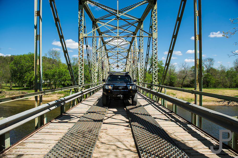 Oklahoma TAT - Bill and Susan Dragoo drive their Toyota Tacoma truck across a rural bridge along the Trans America Trail in eastern Oklahoma. This trail stretches from eastern Tennessee to the Oregon coast using mostly dirt roads and trails.