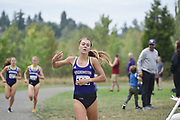 Katie Rainsberger of the Washington Huskies wins the women's 3-mile at the UW/Seattle University open cross country race at Warren G. Magnuson Park in 16:28., Friday, Aug. 30, 2019, in Seattle. (Paul Merca/Image of Sport)