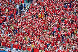 LYON, FRANCE - Wednesday, July 6, 2016: Wales supporters sing the national anthem ahead of the UEFA Euro 2016 Championship Semi-Final match against Portugal at the Stade de Lyon. (Pic by Paul Greenwood/Propaganda)