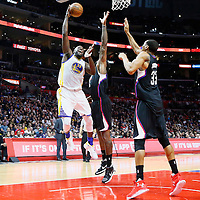 20 February 2016: Golden State Warriors forward Draymond Green (23) goes for the layup over Los Angeles Clippers center DeAndre Jordan (6) and Los Angeles Clippers forward Wesley Johnson (33) during the Golden State Warriors 115-112 victory over the Los Angeles Clippers, at the Staples Center, Los Angeles, California, USA.