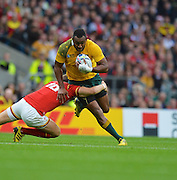 Tevita Kuridrani try to break a tackle during the Rugby World Cup Pool A match between Australia and Wales at Twickenham, Richmond, United Kingdom on 10 October 2015. Photo by Ian Muir.during the Rugby World Cup Pool A match between Australia and Wales at Twickenham, Richmond, United Kingdom on 10 October 2015. Photo by Ian Muir.