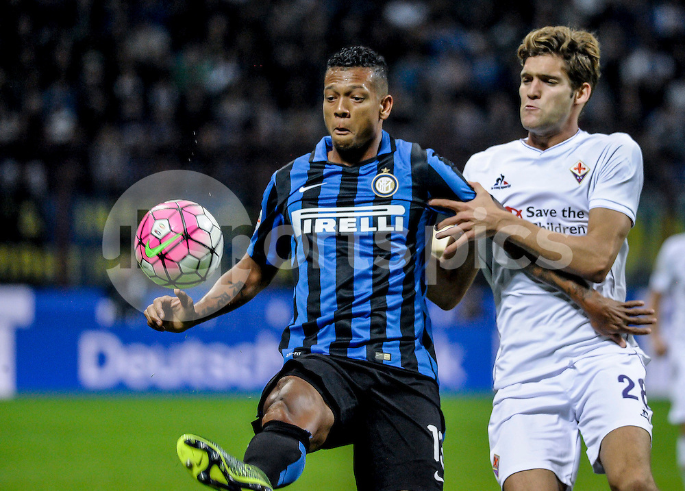 CHELSEA SHOWS INTEREST ON MARCOS ALONSO OF FIORENTINA.<br /> <br /> Fredy Guarin of Inter Milan and Marcos Alonso of Fiorentina during the Serie A TIM match between Inter Milan and Fiorentina at Stadio San Siro, Milan, Italy on 27 September 2015. Photo by sync-studio