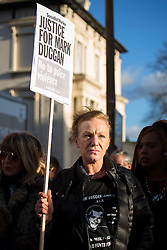 © licensed to London News Pictures. London, UK 11/01/2014. Carole Duggan, aunt of Mark Duggan attending to a vigil for Mark Duggan outside Tottenham Police Station following the inquest jury's conclusion that he was lawfully killed. Mark Duggan was shot dead by police during an attempted arrest in Tottenham, north London, on August 4, 2012. Photo credit: Tolga Akmen/LNP