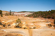 Lunar like despoiled landscape opencast mineral extraction in the Minas de Riotinto mining area, Huelva province, Spain