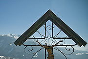 Old crucifix overlooking the Italian Alps of Carnia.