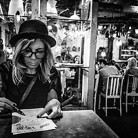 woman in a bar sitting at table