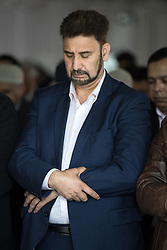 © Licensed to London News Pictures . 12/05/2017 . Manchester , UK . Prospective Parliamentary Candidate for Gorton , AFZAL KHAN at the service . Thousands of people fill a mosque , inside a marquee at the British Muslim Heritage Centre in Whalley Range , Manchester , for the funeral of Mawlana Habib-ur-Rahman , at the British Muslim Heritage Centre , Whalley Range , Manchester . Rahman , a former maths teacher and then imam at Manchester Central Mosque , died aged 90 following heart problems . As a well-known leader of Manchester's Muslim community he promoted interfaith dialogue and met the Pope during a Papal visit to Manchester in 1982 . Due to the number attending , crowds attending the funeral had to be diverted to rooms in nearby buildings to listen to the service via loudspeaker . Photo credit : Joel Goodman/LNP