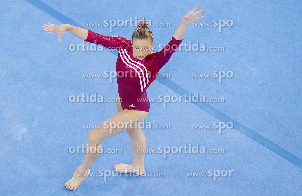 Lisa Ecker of Austria competes in the Floor Exercise during Final day 2 of Artistic Gymnastics World Cup Ljubljana, on April 27, 2013, in Hala Tivoli, Ljubljana, Slovenia. (Photo By Vid Ponikvar / Sportida.com)