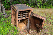 An old 1900s safe decays outdoors. Big Delta State Historical Park: Rika's Roadhouse served travelers on the historic Valdez-to-Fairbanks Trail from 1913 to 1947, at a historically important crossing of the Tanana River. Find it off mile 274.5 of the Richardson Highway in Big Delta, in the Southeast Fairbanks Area, Alaska, USA. Jovo 'John' Hajdukovich, an immigrant from Montenegro, had the north-south section of this log structure built in 1913. Starting in 1917, Swedish immigrant Rika Wallen operated this regional hub serving gold stampeders, local hunters, traders, and freighters; and she bought the roadhouse in 1923. With the construction of the ALCAN (now Alaska) Highway and the replacement of the ferry with a bridge downstream, traffic moved away and patronage declined.