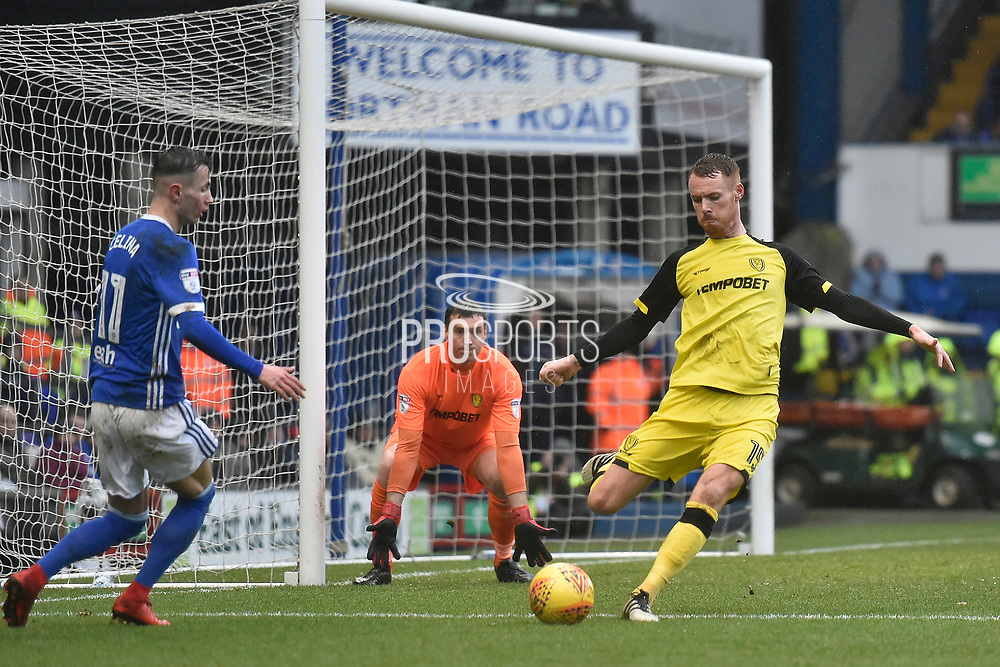 Burton Albion defender Tom Naylor (15) clears from Ipswich Town midfielder Bersant Celina (11) during the EFL Sky Bet Championship match between Ipswich Town and Burton Albion at Portman Road, Ipswich, England on 10 February 2018. Picture by Richard Holmes.