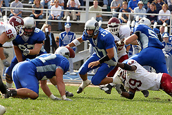 12 OCT 2002  In a bid for first place of the division, Eastern Kentucky Colonels take on the Eastern Illinois Panthers.  Quarterback Tony Romo works to get away from an EKU lineman.  It was EIU's homecoming and action took place in the Stadium on Eastern's campus in Charleston, Illinois.