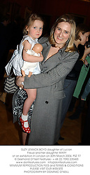 SUZY LENNOX-BOYD daughter of Lucian Freud and her daughter MARY at an exhibition in London on 30th March 2004.PSZ 77