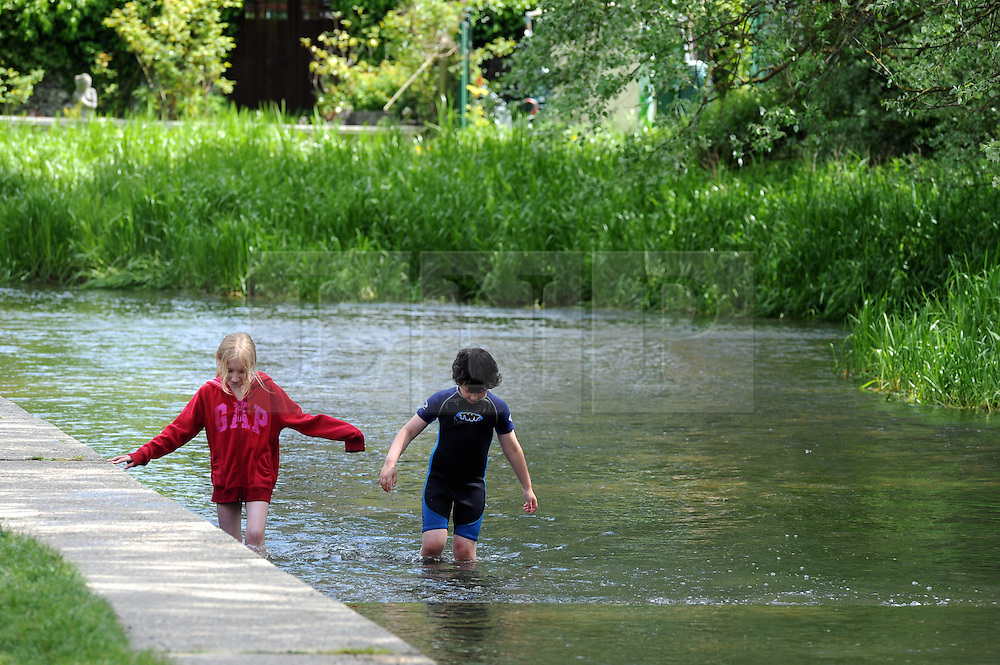 &copy; Licensed to London News Pictures. 03/06/2013<br /> Sunny weather in Kent today 03.06.2013<br /> Familys enjoying an extra days holiday today in Eynsford, Kent due to a teacher training day. Children playing in the river Darent as temperatures are set to rise this week.<br /> Photo credit :Grant Falvey/LNP