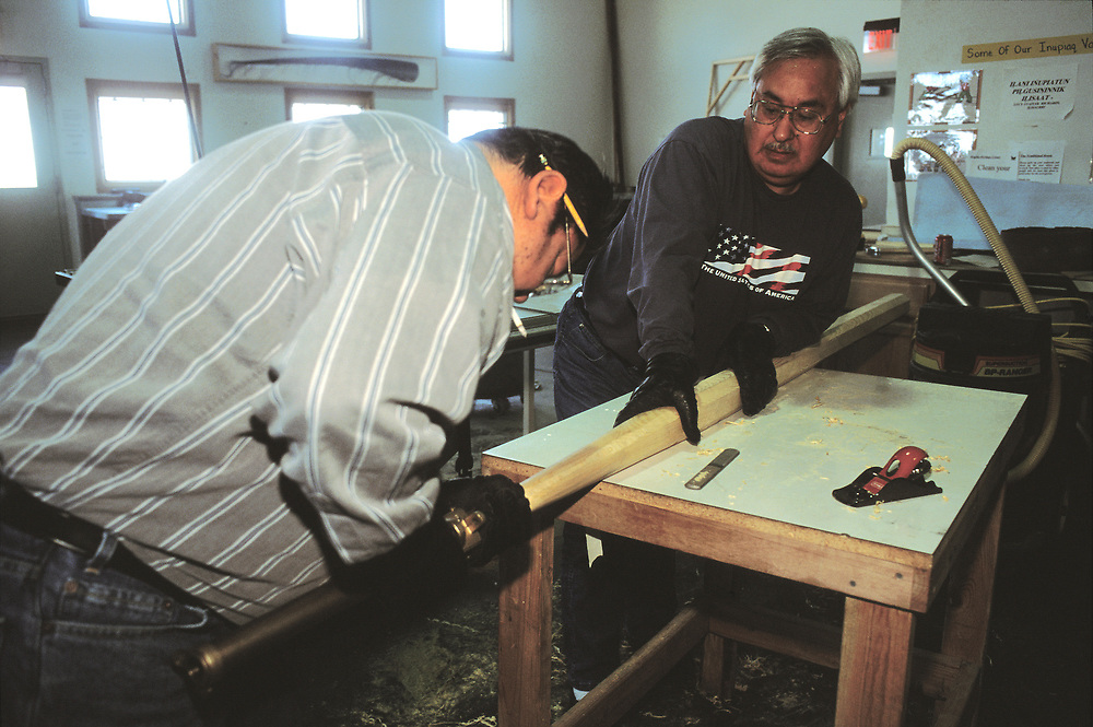 Barrow, Alaska, Native men making a wooden whale harpoon