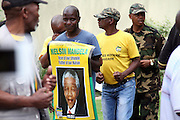 People dancing in celebration of former president Nelson Mandela out his Houghton home, Johannesburg. Scores of people were brought flowers an lit candles in memory of the fallen hero. Mandela died on the December 5 in his Houghton home.Pic. Bafana Mahlangu. Date 05/12/2013. Sowetan