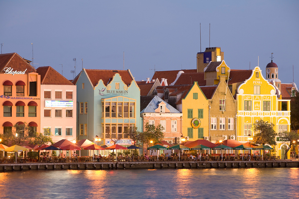 Caribbean, Netherland Antilles, Curacao, Willemstad, Punda quarter. Colorful businesses with traditional colonial architecture in the Dutch style along Willemstad Harbor.  The city center of Willemstad is a UNESCO World Heritage Site.
