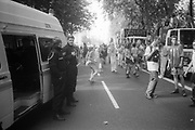 Ravers dancing along side police,at the 2nd Criminal Justice March, Victoria, London, UK, 23rd of July 1994.