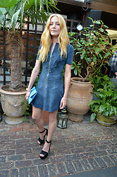 CLARA PAGET at the Warner Music Group Summer Party in association with British GQ held at Shoreditch House, Ebor Street, London E2 on 8th July 2015.