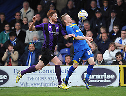 Bristol Rovers' Matt Harrold challenges AFC Wimbledon's Tom Richards - Photo mandatory by-line: Dougie Allward/JMP - Mobile: 07966 386802 05/04/2014 - SPORT - FOOTBALL - Kingston upon Thames - Kingsmeadow - AFC Wimbledon v Bristol Rovers - Sky Bet League Two