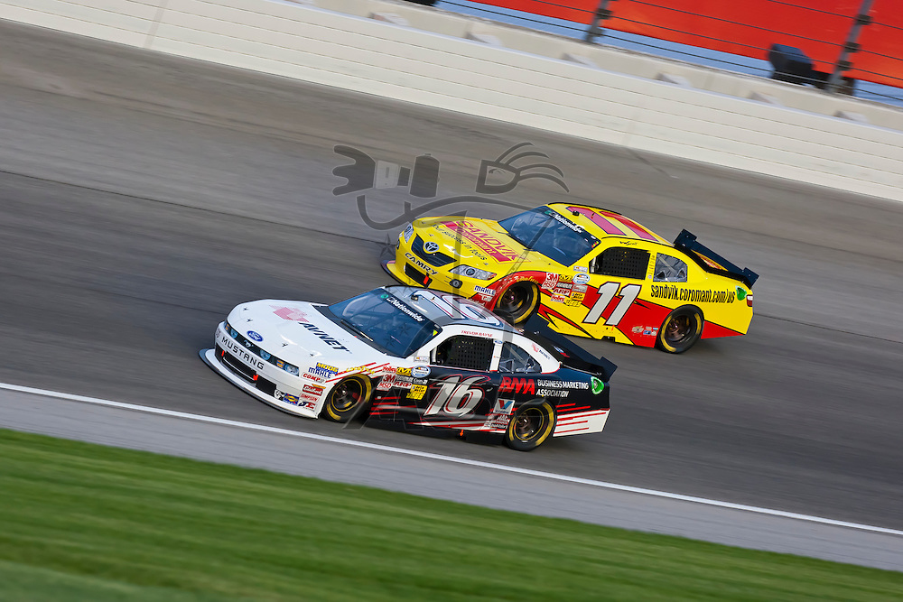 JOLIET, IL - JUNE 04, 2011:  Trevor Bayne (16) battles for position during the STP 300 race at the Chicagoland Speedway in Joliet, IL.