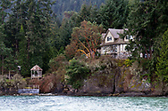 This house on Beddis Road has a great waterfront view of Captain Passage. Photographed from Beddis Beach on Salt Spring Island, British Columbia, Canada.