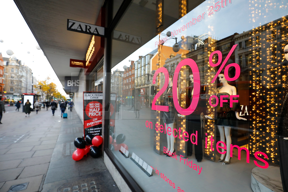 """© Licensed to London News Pictures. 25/11/2016. London, UK. Deserted streets and empty shops in the early hours on Oxford Street in central London on """"Black Friday"""". Sales from this years Black Friday event are expected to top £2 billion. Photo credit: Tolga Akmen/LNP"""