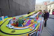 "Vienna. MuseumsQuartier (MQ Vienna) is celebrating its 10th year..""Race Around Europe"" slot car racing."