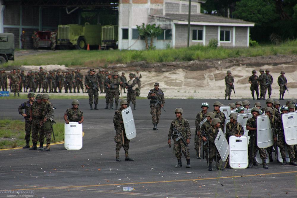 "Tegucigalpa, Honduras. July 5th, 2009. A plane carrying deposed President Manuel ""Mel"" Zelaya, scheduled to return from Nicaragua after being forcibly removed from power by a Coup d'Etat on June 28th, 2009, could not land as members of the Honduran Armed Forces blocked the landing strip."