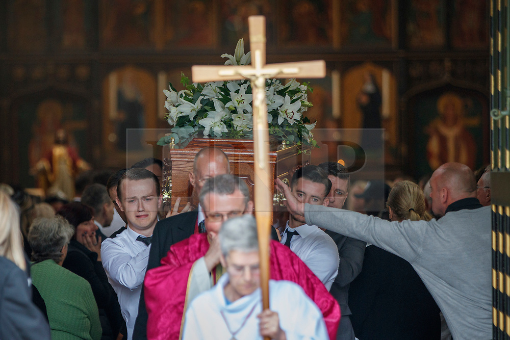 © Licensed to London News Pictures. 29/06/2017. London, UK. Funeral of Grenfell fire victim Tony Disson takes place at Our Lady of the Holy Souls RC church in the Notting Hill area of west London on 29 June 2017. Mr Disson is one of only a handful of the 80 victims to have been identified and named so far. Photo credit: Tolga Akmen/LNP
