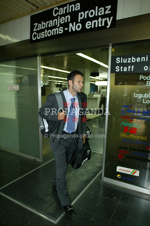 BELGRADE, SERBIA & MONTENEGRO - Monday, August 18, 2003: Wales' Ryan Giggs arrives at Belgrade Airport ahead of his side's UEFA European Championship Group 9 qualifying match against Serbia & Montenegro. (Photo by David Rawcliffe/Propaganda)