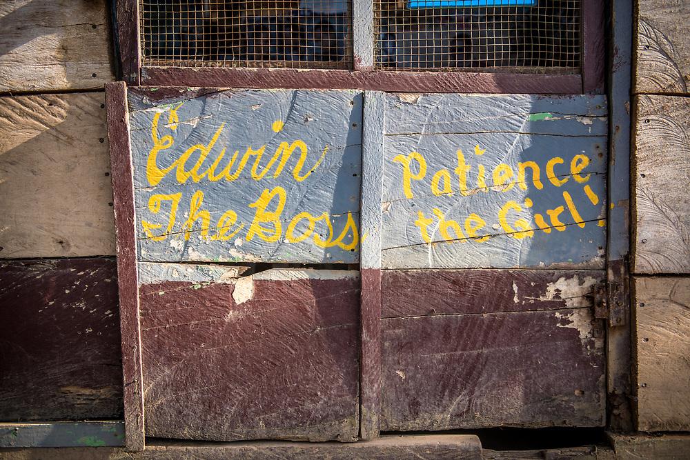 "A shop gate  reads ""Edwin The Boss, Patience the Girl!"" Ganta, Liberia"