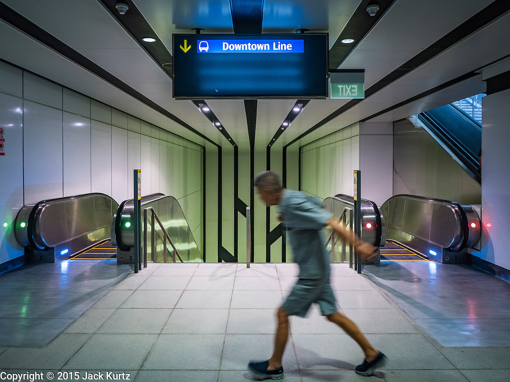 "27 DECEMBER 2015 - SINGAPORE, SINGAPORE:  A man walks into the Rochor subway station in the Little India section of Singapore on the first day the station was open. Singapore opened the extension of the Downtown Line on its subway system Sunday. The extension is a part of Singapore's plans to make the city-state a ""car lite"" metropolis with plans to double the current subway to more than 360 kilometers of track by 2030. The government plans to have 80% of homes within a 10 minute walk of a subway station.   PHOTO BY JACK KURTZ"