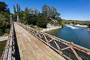 The Clifden Suspension Bridge was the first bridge built over the Waiau River, back in the 19th century.  Southland, New Zealand.