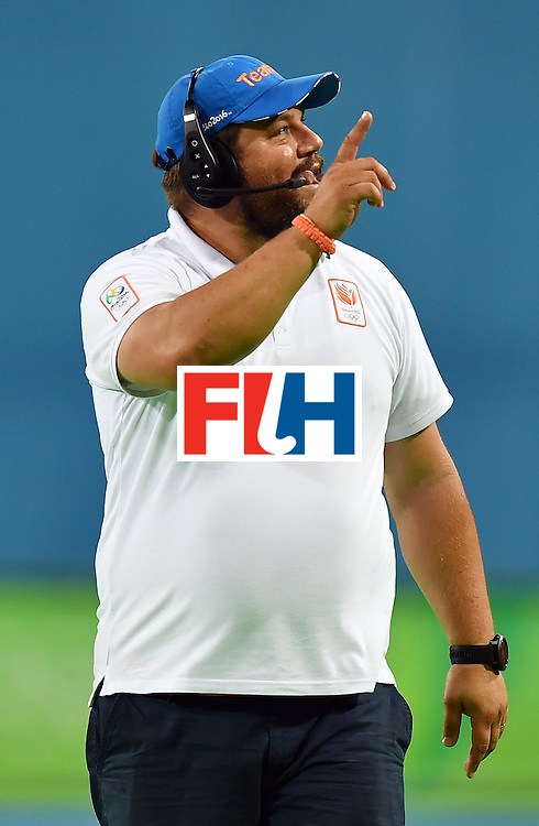 Netherland's coach Max Caldas gestures at the end of the men's quarterfinal field hockey Netherlands vs Australia match of the Rio 2016 Olympics Games at the Olympic Hockey Centre in Rio de Janeiro on August 14, 2016. / AFP / MANAN VATSYAYANA        (Photo credit should read MANAN VATSYAYANA/AFP/Getty Images)