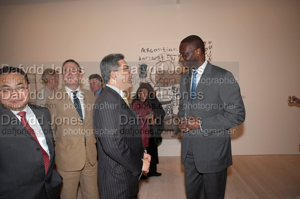 Yuri O Thamrin; Indonesian Ambassador; Tidjane Thiam , Indonesian Eye Contemporary Art Exhibition Reception, Saatchi Gallery. London. 9 September 2011. <br /> <br />  , -DO NOT ARCHIVE-© Copyright Photograph by Dafydd Jones. 248 Clapham Rd. London SW9 0PZ. Tel 0207 820 0771. www.dafjones.com.