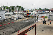 "Annapolis, Maryland - June 05, 2016: Three hours after a perigean spring tide flooded the 5th street entrance to the Annapolis City Marina loading dock, the waters have receded well past the dock. Low tide for the day was still three hours away. <br /> <br /> <br /> A perigean spring tide brings nuisance flooding to Annapolis, Md. These phenomena -- colloquially know as a ""King Tides"" -- happen three to four times a year and create the highest tides for coastal areas, except when storms aren't a factor. Annapolis is extremely susceptible to nuisance flooding anyway, but the amount of nuisance flooding has skyrocketed in the last ten years. Scientists point to climate change for this uptick. <br /> <br /> <br /> CREDIT: Matt Roth for The New York Times<br /> Assignment ID: 30191272A"