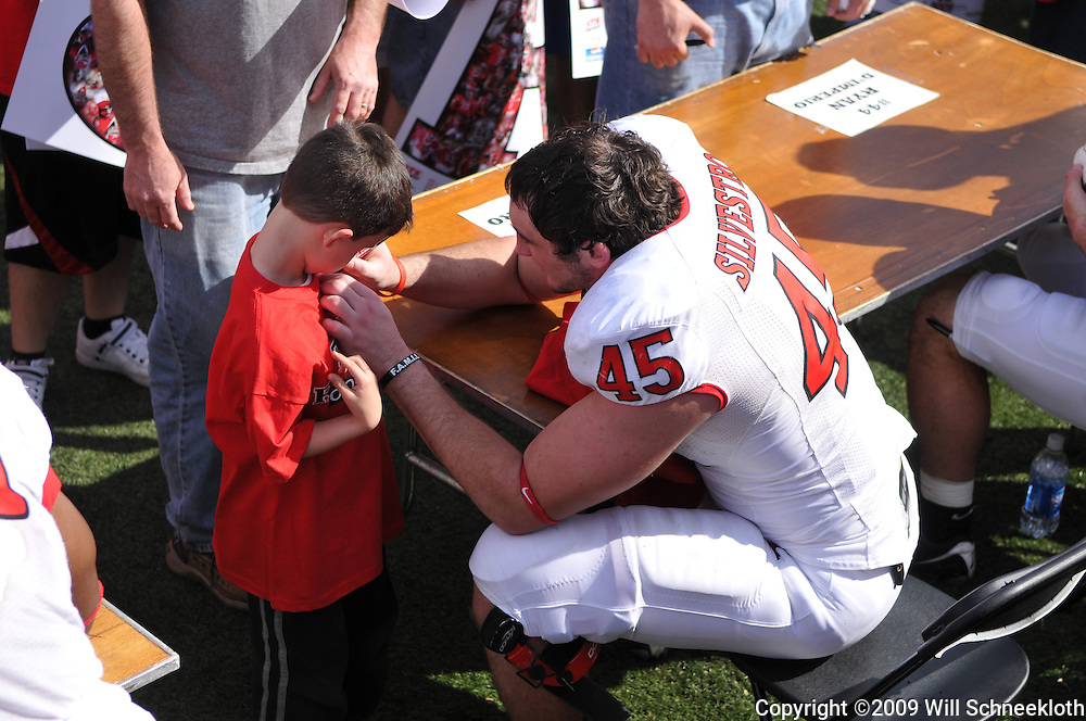 Apr 18, 2009; Piscataway, NJ, USA; Rutgers DE Alex Silvestro (45) signs a fans' shirt following Rutgers' Scarlet and White spring football scrimmage.