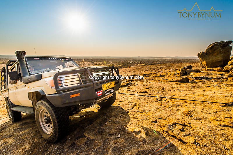 hunting photograph hunting africa winching truck up rock surface