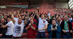 STOKE-ON-TRENT, ENGLAND - Sunday, August 9, 2015: Liverpool supporters celebrate their side's winning late goal against Stoke City during the Premier League match at the Britannia Stadium. (Pic by David Rawcliffe/Propaganda)