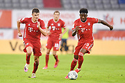 v.l. Benjamin Pavard, Alphonso Davies (Bayern) during the Bayern Munich vs Eintracht Frankfurt, German Cup Semi-Final at Allianz Arena, Munich, Germany on 10 June 2020.