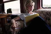 "Judy Rivers of Cullman, Alabama, sits in the RV that has been her temporary home for the past two years. When the credit system declared her dead in 2010, Rivers struggled to get a job because she failed background checks and no longer had a credit history. In May 2012, she was finally ""resurrected"" and once again able to open a checking account. In her spare time, Rivers researches the surprisingly regular phenomenon of credit deaths in America, with the hope of helping others who share her predicament."