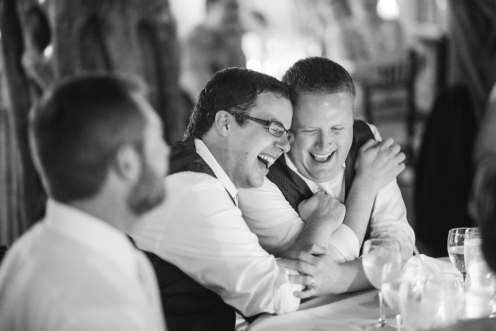 Two grooms during their Puerto Vallarta wedding reception.