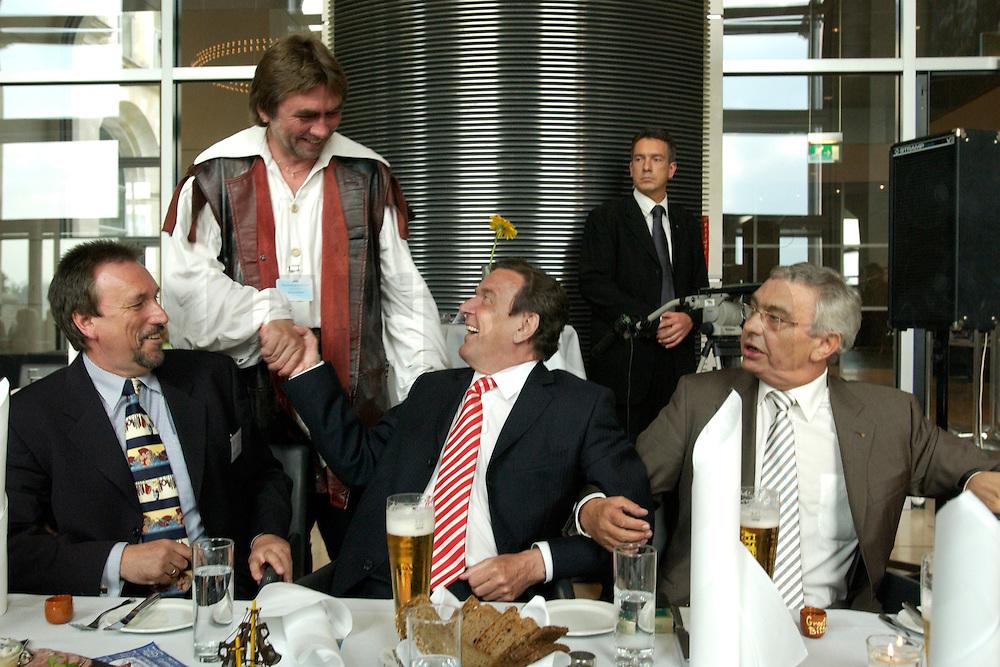 27 APR 2004, BERLIN/GERMANY:<br /> Gerhard Schroeder (M), SPD, Bundeskanzler, wird von einem Klaus St&ouml;rtebecker (Friesischer Seeraeuber) begruesst. Links: Reiner Alberts, Regional-Marketing Norderfleisch, Rechts: Jann-Peter Janssen, MdB, SPD, aus dem ostfriesischen Wahlkreis Aurich-Emden, waehrend dem Eroeffnungsabend der 1. kulinarischen Ostfriesland-Woche, Abgeordneten-Restaurant des Deutschen Bundestages, Rechstagsgebaeude<br /> IMAGE: 20040427-04-023<br /> KEYWORDS: Gerhard Schr&ouml;der, Regional-Marketing Norderfleisch, Parlamentarischer Abend