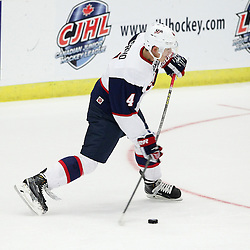 COBOURG, - Dec 14, 2015 -  Game #3 - United States vs Czech Republic at the 2015 World Junior A Challenge at the Cobourg Community Centre, ON. John Marino #4 of Team United States shoots the puck during the second period.(Photo: Tim Bates / OJHL Images)
