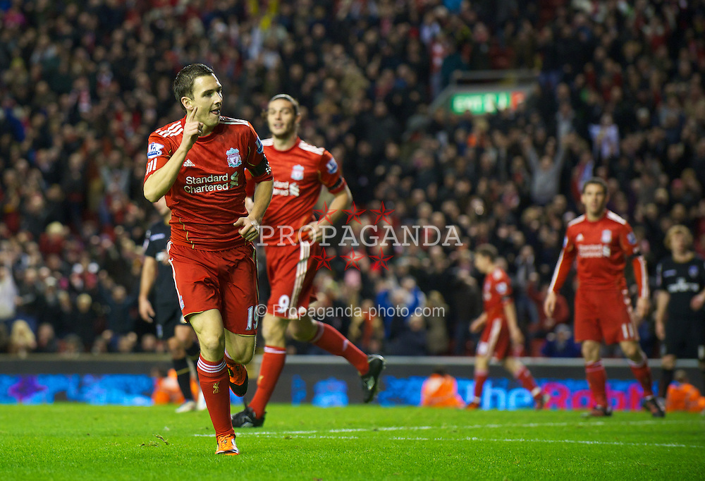LIVERPOOL, ENGLAND - Friday, January 6, 2012: Liverpool's Stewart Downing celebrates scoring his first goal for the club, his side's fifth against Oldham Athletic during the FA Cup 3rd Round match at Anfield. (Pic by David Rawcliffe/Propaganda)