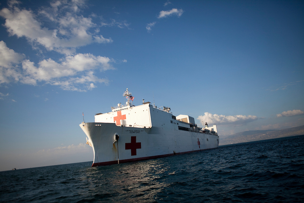 The USNS Comfort, a naval hospital ship, is anchored off the coast of Port-au-Prince, Haiti on Wednesday, January 20, 2010. The Comfort deployed from Baltimore, bringing nearly a thousand medical personnel to care for victims of Haiti's recent earthquake.