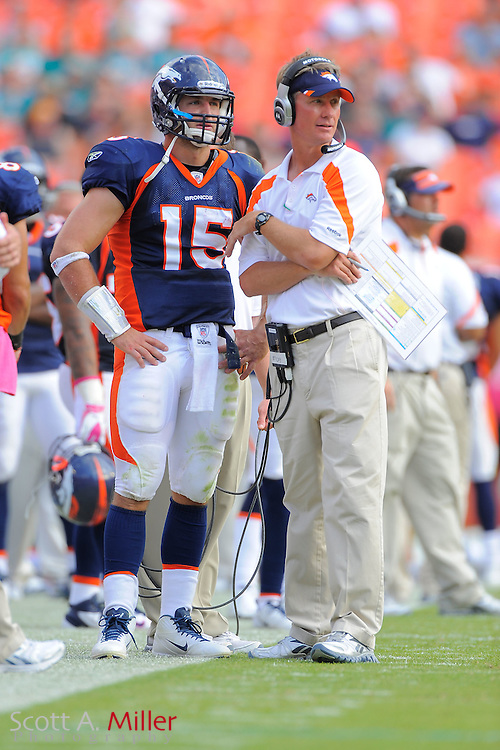 Denver Broncos quarterback Tim Tebow (15) with offensive coordinator Mike McCoy during the Broncos 18-15 OT win over the Miami Dolphins at Sunlife Stadium on Oct. 22, 2011 in Miami Gardens, Fla. ..©2011 Scott A. Miller